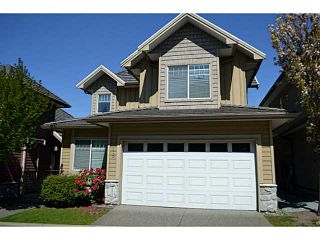 """Photo 1: 18 3363 ROSEMARY HEIGHTS Crescent in Surrey: Morgan Creek Townhouse for sale in """"ROCKWELL"""" (South Surrey White Rock)  : MLS®# F1438051"""