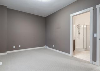 Photo 21: 106 WEST SPRINGS Road SW in Calgary: West Springs Row/Townhouse for sale : MLS®# A1128292