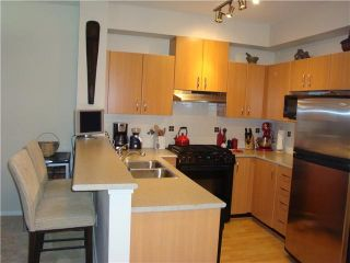 """Photo 2: 418 801 KLAHANIE Drive in Port Moody: Port Moody Centre Condo for sale in """"INGLENOOK KLAHANIE"""" : MLS®# V970501"""