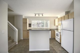 Photo 11: 25 Tuscany Springs Gardens NW in Calgary: Tuscany Row/Townhouse for sale : MLS®# A1053153