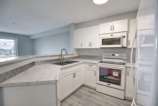 Photo 5: 7312 304 Mackenzie Way: Airdrie Apartment for sale : MLS®# A1118474