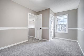 Photo 24: 52 COUGARSTONE Villa SW in Calgary: Cougar Ridge Detached for sale : MLS®# A1020063