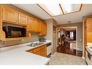 """Photo 8: 103 5641 201 Street in Langley: Langley City Townhouse for sale in """"THE HUNTINGTON"""" : MLS®# R2537246"""