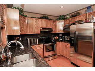 Photo 19: 39 SANDALWOOD Heights NW in Calgary: Sandstone House for sale : MLS®# C4025285