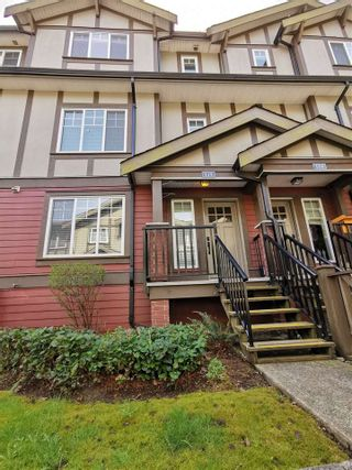"Photo 1: 115 3333 DEWDNEY TRUNK Road in Port Moody: Port Moody Centre Townhouse for sale in ""CENTREPOINT"" : MLS®# R2561726"