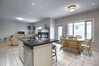 Photo 8: 523 KLARVATTEN LAKE WYND Wynd in Edmonton: Zone 28 House for sale : MLS®# E4226587