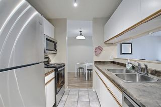 Photo 13: 207 33 Arbour Grove Close NW in Calgary: Arbour Lake Apartment for sale : MLS®# A1135288