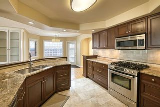 Photo 8: 7 Laneham Place SW in Calgary: North Glenmore Park Detached for sale : MLS®# A1097767