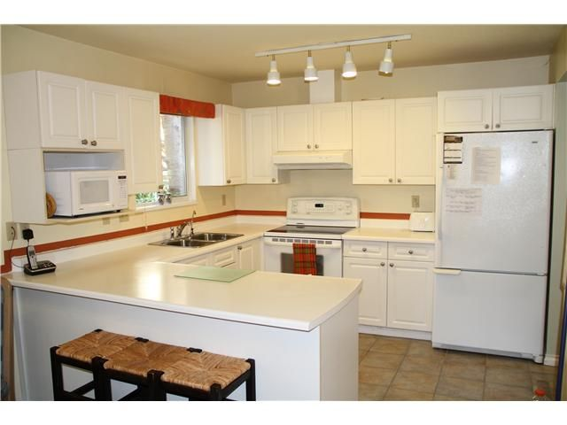 """Main Photo: 3918 INDIAN RIVER DR in North Vancouver: Indian River Condo for sale in """"HIGHGATE TERRACE"""" : MLS®# V880705"""