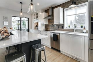 Main Photo: 84 Coach Side Terrace SW in Calgary: Coach Hill Semi Detached for sale : MLS®# A1077504