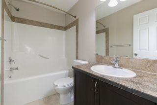 Photo 17: 58 Arbours Circle NW: Langdon Row/Townhouse for sale : MLS®# A1137898