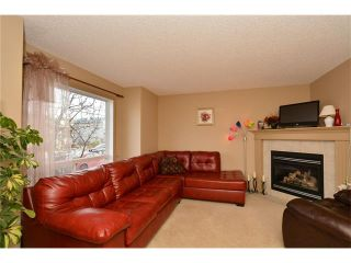 Photo 2: 202 ARBOUR MEADOWS Close NW in Calgary: Arbour Lake House for sale : MLS®# C4048885