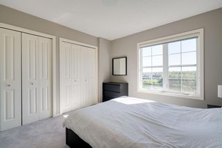 Photo 15: 111 Ascot Point SW in Calgary: Aspen Woods Row/Townhouse for sale : MLS®# A1144877