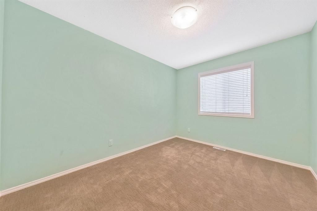 Photo 25: Photos: 53 Bridleridge Heights SW in Calgary: Bridlewood Detached for sale : MLS®# A1129360