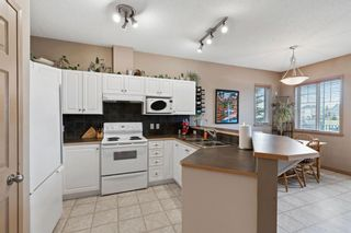 Photo 7: 111 2 Westbury Place SW in Calgary: West Springs Row/Townhouse for sale : MLS®# A1112169