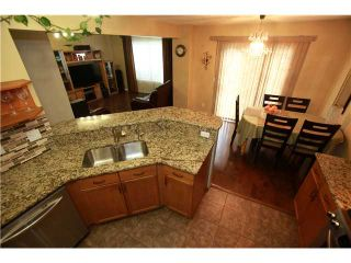 Photo 6: 144 ARBOUR STONE Crescent NW in CALGARY: Arbour Lake Residential Detached Single Family for sale (Calgary)  : MLS®# C3629309