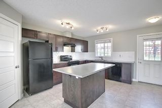Photo 3: 166 PANTEGO Lane NW in Calgary: Panorama Hills Row/Townhouse for sale : MLS®# A1110965