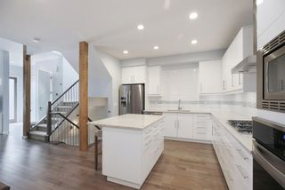Photo 3: 2 4713 17 Avenue NW in Calgary: Montgomery Row/Townhouse for sale : MLS®# A1135543