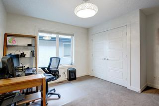 Photo 29: 127 Springbluff Boulevard SW in Calgary: Springbank Hill Detached for sale : MLS®# A1140601