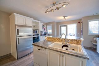 Photo 4: 5511 Strathcona Hill SW in Calgary: Strathcona Park Detached for sale