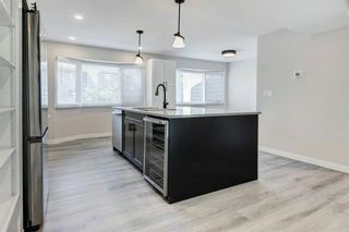 Photo 9: 92 23 Glamis Drive SW in Calgary: Glamorgan Row/Townhouse for sale : MLS®# A1153532