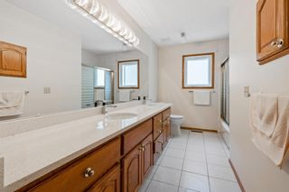 Photo 30: 927 Shawnee Drive SW in Calgary: Shawnee Slopes Detached for sale : MLS®# A1123376