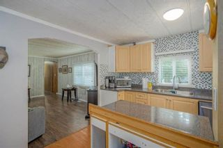 """Photo 6: 182 7790 KING GEORGE Boulevard in Surrey: East Newton Manufactured Home for sale in """"CRISPEN BAYS"""" : MLS®# R2591510"""