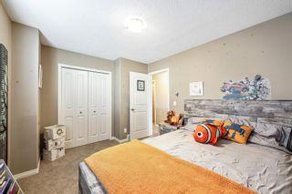 Photo 21: 494 Boulder Creek Way SE: Langdon Semi Detached for sale : MLS®# A1148702