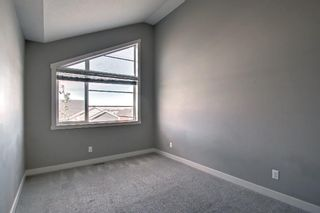 Photo 15: 555 Redstone View NE in Calgary: Redstone Row/Townhouse for sale : MLS®# A1149779