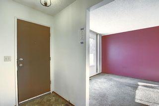 Photo 2: 63 740 Bracewood Drive SW in Calgary: Braeside Row/Townhouse for sale : MLS®# A1058540