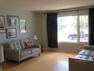 Photo 2: 357 Woodvale Crescent SW in Calgary: Woodlands Semi Detached for sale : MLS®# A1135631