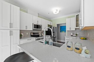 """Photo 15: 207 5 RENAISSANCE Square in New Westminster: Quay Townhouse for sale in """"THE LIDO"""" : MLS®# R2617609"""