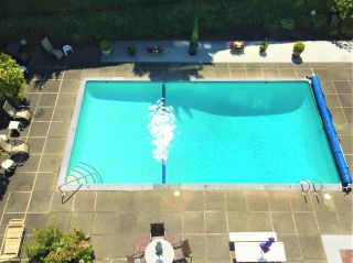 """Photo 1: 406 6076 TISDALL Street in Vancouver: Oakridge VW Condo for sale in """"THE MANSION HOUSE ESTATES LTD"""" (Vancouver West)  : MLS®# R2409487"""