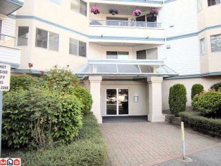 """Photo 1: 204 5377 201A Street in Langley: Langley City Condo for sale in """"RED MAPLE PLACE"""" : MLS®# R2095794"""