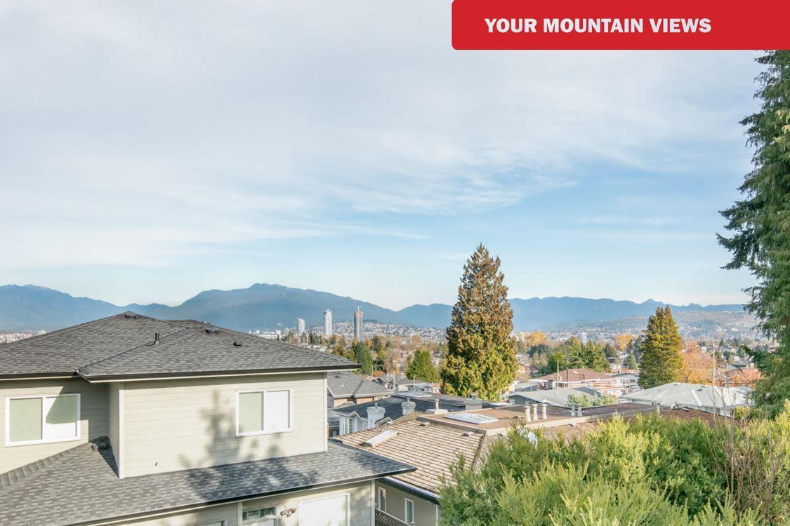 STUNNING MOUNTAIN VIEWS on main & upper floors