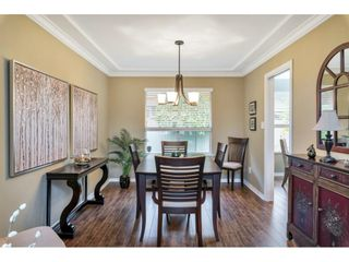 """Photo 7: 118 6109 W BOUNDARY Drive in Surrey: Panorama Ridge Townhouse for sale in """"LAKEWOOD GARDENS"""" : MLS®# R2625696"""