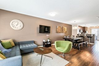 Photo 2: 1562 93 Street SW in Calgary: Aspen Woods Row/Townhouse for sale : MLS®# A1085332