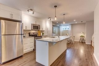 Photo 8: 218 Cranford Mews SE in Calgary: Cranston Row/Townhouse for sale : MLS®# A1127367