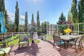 Photo 11: 31 Strathlea Common SW in Calgary: Strathcona Park Detached for sale : MLS®# A1147556