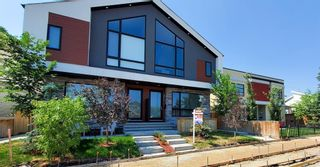 Main Photo: 1 4811 Bowness Road NW in Calgary: Montgomery Row/Townhouse for sale : MLS®# A1126459
