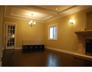 """Photo 6: 1950 E 64TH Avenue in Vancouver: Fraserview VE House for sale in """"FRASERVIEW"""" (Vancouver East)  : MLS®# V785070"""