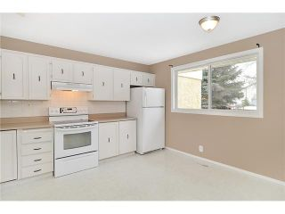 Photo 4: 409 RANCHVIEW Court NW in CALGARY: Ranchlands Residential Attached for sale (Calgary)  : MLS®# C3554095