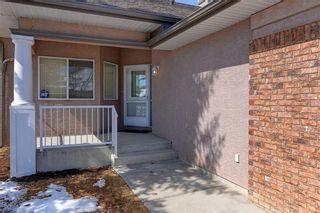 Photo 2: 5 STRADDOCK Villa SW in Calgary: Strathcona Park Semi Detached for sale : MLS®# C4293573