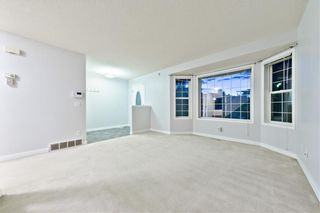 Photo 3: 167 BRIDLEWOOD CM SW in Calgary: Bridlewood House for sale