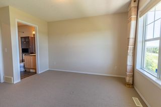 Photo 23: 119 Toscana Gardens NW in Calgary: Tuscany Row/Townhouse for sale : MLS®# A1121039