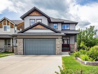 Photo 1: 159 ST MORITZ Drive SW in Calgary: Springbank Hill Detached for sale : MLS®# A1116300