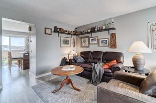 Photo 7: 32 800 Bowcroft Place: Cochrane Row/Townhouse for sale : MLS®# A1106385