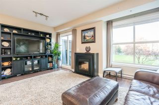 "Photo 10: 205 2110 ROWLAND Street in Port Coquitlam: Central Pt Coquitlam Townhouse for sale in ""AVIVA ON THE PARK"" : MLS®# R2521189"