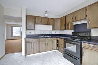 Photo 19: 329 Woodvale Crescent SW in Calgary: Woodlands Semi Detached for sale : MLS®# A1093334