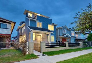 Photo 1: 2158 MANNERING Avenue in Vancouver: Collingwood VE 1/2 Duplex for sale (Vancouver East)  : MLS®# R2309901